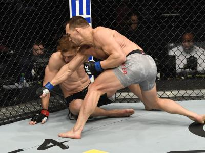 ABU DHABI, UNITED ARAB EMIRATES - JANUARY 23: (R-L) Michael Chandler punches Dan Hooker of New Zealand in a lightweight fight during the UFC 257