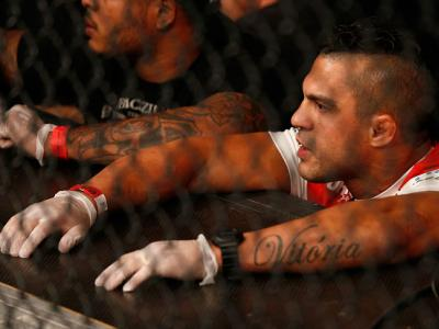 RIO DE JANEIRO, BRAZIL - OCTOBER 25:  Coach Vitor Belfort of Brazil is seen in the corner of Gilbert Burns as he battles Christos Giagos in a lightweight bout during the UFC 179 event at Maracanazinho on October 25, 2014 in Rio de Janeiro, Brazil.  (Photo