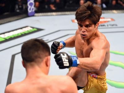 DALLAS, TX - MARCH 14:  (R-L) Henry Cejudo punches Chris Cariaso in their flyweight bout during the UFC 185 event at the American Airlines Center on March 14, 2015 in Dallas, Texas. (Photo by Josh Hedges/Zuffa LLC/Zuffa LLC via Getty Images)