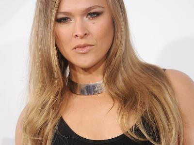 """HOLLYWOOD, CA - APRIL 01:  UFC champion Ronda Rousey arrives at the Los Angeles premiere of """"Furious 7"""" at TCL Chinese Theatre IMAX on April 1, 2015 in Hollywood, California.  (Photo by Gregg DeGuire/WireImage)"""