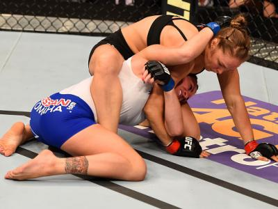 LOS ANGELES, CA - FEBRUARY 28:  (Top) Ronda Rousey grapples with Cat Zingano in their UFC women's bantamweight championship bout during the UFC 184 event at Staples Center on February 28, 2015 in Los Angeles, California.  (Photo by Josh Hedges/Zuffa LLC/Z
