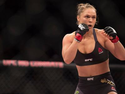 RIO DE JANEIRO, BRAZIL - AUGUST 01:  UFC women's bantamweight champion Ronda Rousey of the United States rushes forward against Bethe Correia of Brazil during the UFC 190 event inside HSBC Arena on August 1, 2015 in Rio de Janeiro, Brazil.  (Photo by Jeff