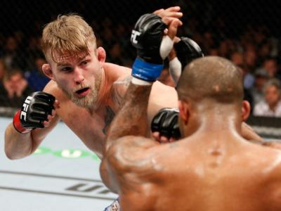LONDON, ENGLAND - MARCH 08:  (L-R) Alexander Gustafsson punches Jimi Manuwa in their light heavyweight fight during the UFC Fight Night London event at the O2 Arena on March 8, 2014 in London, England. (Photo by Josh Hedges/Zuffa LLC/Zuffa LLC via Getty I