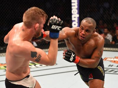 HOUSTON, TX - OCTOBER 03:  (R-L) Daniel Cormier punches Alexander Gustafsson in their UFC light heavyweight championship bout during the UFC 192 event at the Toyota Center on October 3, 2015 in Houston, Texas. (Photo by Josh Hedges/Zuffa LLC/Zuffa LLC via