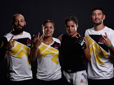 HOUSTON, TX - OCTOBER 03:  Julianna Pena poses for a post fight portrait with her team backstage during the UFC 192 event at the Toyota Center on October 3, 2015 in Houston, Texas. (Photo by Mike Roach/Zuffa LLC/Zuffa LLC via Getty Images)