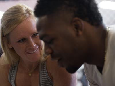 ALBUQUERQUE, NM - OCTOBER 31: (L-R) Holly Holm and Jon Jones sign autographs for fans during the Jackson Wink MMA Academy Grand Opening at Jackson's Mixed Martial Arts & Fitness on October 31, 2015 in Albuquerque, New Mexico. (Photo by Brandon Magnus/Zuff