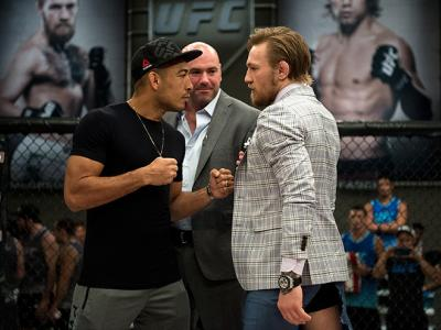 LAS VEGAS, NV - AUGUST 26:  (R-L) UFC interim featherweight champion Conor McGregor and UFC featherweight Champion Jose Aldo face off during the filming of The Ultimate Fighter: Team McGregor vs Team Faber at the UFC TUF Gym on August 26, 2015 in Las Vega