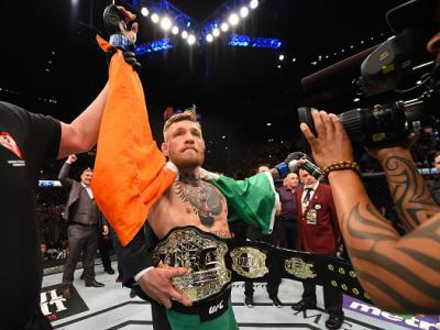 LAS VEGAS, NV - DECEMBER 12:  Conor McGregor of Ireland reacts to his victory over Jose Aldo of Brazil in their UFC featherweight championship bout during the UFC 194 event inside MGM Grand Garden Arena on December 12, 2015 in Las Vegas, Nevada.  (Photo b