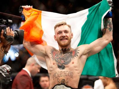 LAS VEGAS, NV - DECEMBER 12:  Conor McGregor celebrates after a first-round knockout victory over Jose Aldo in their featherweight title fight during UFC 194 on December 12, 2015 in Las Vegas, Nevada.  (Photo by Steve Marcus/Getty Images)