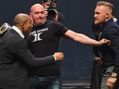 LAS VEGAS, NV - SEPTEMBER 04:  (L-R) UFC featherweight champion Jose Aldo and featherweight interim champion Conor McGregor face offduring the UFC's Go Big launch event inside MGM Grand Garden Arena on September 4, 2015 in Las Vegas, Nevada.  (Photo by Jo