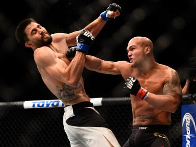 LAS VEGAS, NV - JANUARY 02:  (R-L) Robbie Lawler punches Carlos Condit in their UFC welterweight championship bout during the UFC 195 event inside MGM Grand Garden Arena on January 2, 2016 in Las Vegas, Nevada.  (Photo by Jeff Bottari/Zuffa LLC/Zuffa LLC