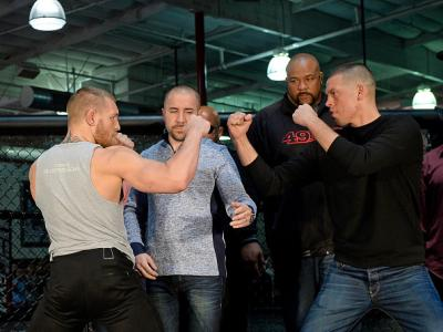 TORRANCE, CA - FEBRUARY 24:  UFC featherweight champion Conor McGregor (L) and lightweight contender Nate Diaz (R) are held apart by Dave Sholler (2nd L), UFC vice president of public relations, after a news conference at UFC Gym February 24, 2016, in Tor
