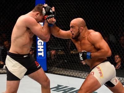 LAS VEGAS, NV - MARCH 05:  (R) Ilir Latifi punches Gian Villante in their light heavyweight bout during the UFC 196 event inside MGM Grand Garden Arena on March 5, 2016 in Las Vegas, Nevada.  (Photo by Josh Hedges/Zuffa LLC/Zuffa LLC via Getty Images)