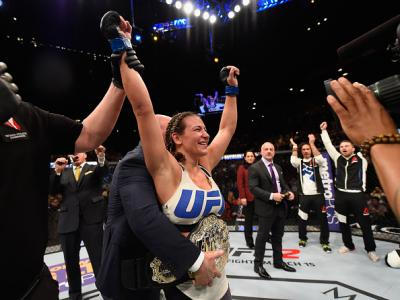 LAS VEGAS, NV - MARCH 05:  Miesha Tate reacts to her victory over Holly Holm in their UFC women's bantamweight championship bout during the UFC 196 event inside MGM Grand Garden Arena on March 5, 2016 in Las Vegas, Nevada.  (Photo by Josh Hedges/Zuffa LLC