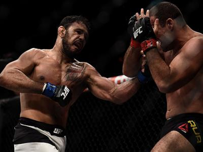 RIO DE JANEIRO, BRAZIL - AUGUST 01:  Antonio Rogerio Nogueira punches Mauricio Rua of Brazil Brazil in their light heavyweight bout during the UFC 190 Rousey v Correia at HSBC Arena on August 1, 2015 in Rio de Janeiro, Brazil.  (Photo by Buda Mendes/Zuffa