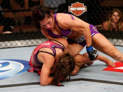 LAS VEGAS, NV - APRIL 13: Cat Zingano (top) punches Miesha Tate in their bantamweight fight at the Mandalay Bay Events Center on April 13, 2013 in Las Vegas, Nevada. (Photo by Josh Hedges/Zuffa LLC/Zuffa LLC via Getty Images)