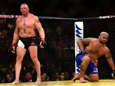 LAS VEGAS, NV - JULY 09: (L-R) Brock Lesnar and Mark Hunt of New Zealand return to their corners after round one in their heavyweight bout during the UFC 200 event on July 9, 2016 at T-Mobile Arena in Las Vegas, Nevada.  (Photo by Harry How/Zuffa LLC/Zuff