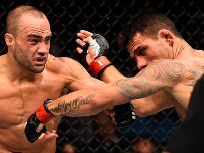 JULY 07: (L-R) Eddie Alvarez connects with a left against Rafael Dos Anjos of Brazil in their lightweight championship bout during the UFC Fight Night event inside the MGM Grand Garden Arena on July 7, 2016 in Las Vegas, Nevada. (Photo by Jeff Bottari/Zuf