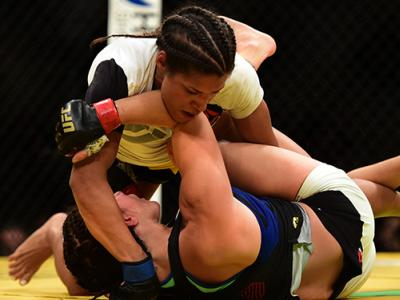 JULY 09: Julianna Pena (top) grapples with Cat Zingano in their women's bantamweight bout during the UFC 200 event on July 9, 2016 at T-Mobile Arena in Las Vegas, Nevada. (Photo by Harry How/Zuffa LLC/Zuffa LLC via Getty Images)