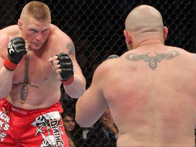 LAS VEGAS - JULY 03:  (L-R) Brock Lesnar takes on Shane Carwin during the UFC Heavyweight Championship Unification bout at the MGM Grand Garden Arena on July 3, 2010 in Las Vegas, Nevada.  (Photo by Josh Hedges/Zuffa LLC/Zuffa LLC via Getty Images)
