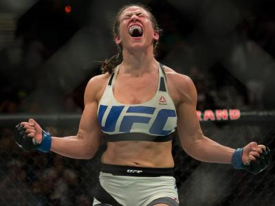 LAS VEGAS, NV - MARCH 5:   Miesha Tate celebrates her submission victory over Holly Holm after their women's bantamweight championship  bout during the UFC 196 in the MGM Grand Garden Arena on March 5, 2016 in Las Vegas, Nevada. (Photo by Brandon Magnus/Z