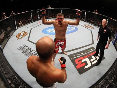 LAS VEGAS, NV - OCTOBER 29:  Nick Diaz (red shorts) taunts BJ Penn during the UFC 137 event at the Mandalay Bay Events Center on October 29, 2011 in Las Vegas, Nevada.  (Photo by Jed Jacobsohn/Zuffa LLC/Zuffa LLC via Getty Images)