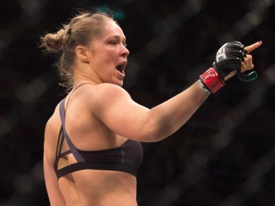 RIO DE JANEIRO, BRAZIL - AUGUST 01:  UFC women's bantamweight champion Ronda Rousey celebrates after defeating Bethe Correia of Brazil by KO during the UFC 190 event inside HSBC Arena on August 1, 2015 in Rio de Janeiro, Brazil.  (Photo by Jeff Bottari/Zu