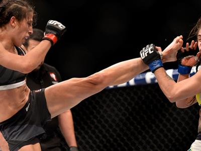 JULY 08: (L-R) Joanna Jedrzejczyk of Poland kicks Claudia Gadelha of Brazil in their women's strawweight championship bout during The Ultimate Fighter Finale event at MGM Grand Garden Arena on July 8, 2016 in Las Vegas, Nevada. (Photo by Brandon Magnus/Zu