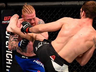 JULY 30: (R-L) Nikita Krylov kicks Ed Herman in their light heavyweight bout during the UFC 201 event on July 30, 2016 at Philips Arena in Atlanta, Georgia. (Photo by Jeff Bottari/Zuffa LLC/Zuffa LLC via Getty Images)