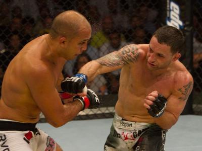 Frankie Edgar (white/green shorts) def. BJ Penn (white shorts) - Unanimous decision during UFC 112