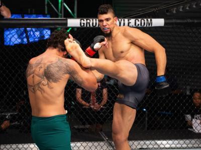 Johnny Walker of Brazil kicks Luiz Henrique da Silva of Brazil in their light heavyweight bout during Dana White's Contender Series Brazil