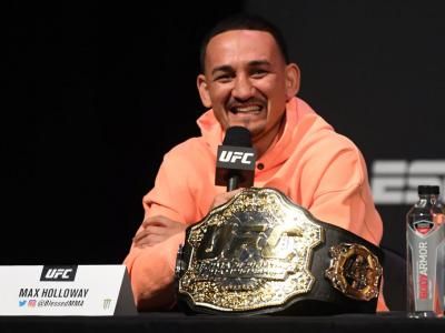 UFC featherweight champion Max Holloway interacts with the media during the UFC seasonal press conference