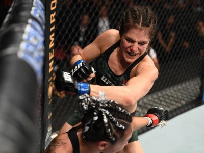 Alexa Grasso of Mexico punches Carla Esparza in their women's strawweight bout during the UFC Fight Night