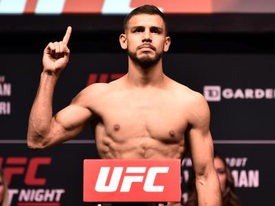 Yair Rodriguez poses on the scale during the UFC weigh-in during the UFC weigh-in