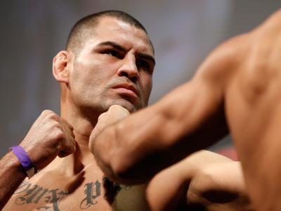 Cain Velasquez faces off with opponent Junior Dos Santos during the UFC 166 weigh-in