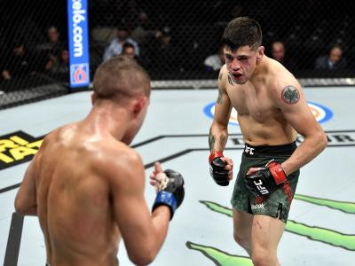 Brandon Moreno of Mexico stares down Kai Kara-France of New Zealand in their flyweight bout during the UFC 245.