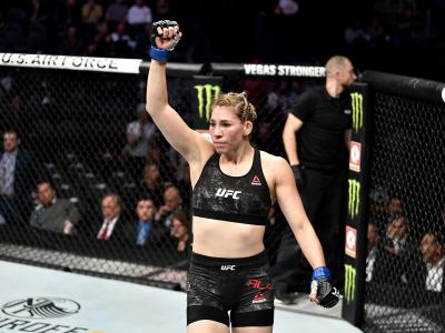 Irene Aldana of Mexico celebrates her victory over Ketlen Vieira of Brazil in their women's bantamweight bout during the UFC 245