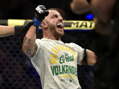 Alexander Volkanovski of Australia celebrates his win in the octagon during the UFC 245