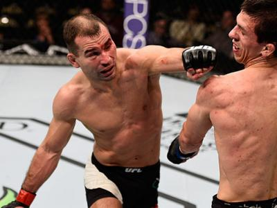 LAS VEGAS, NV - FEB. 06: (L-R)Artem Lobov of Russia punches Alex White in their featherweight bout during the UFC Fight Night event. (Photo by Jeff Bottari/Zuffa LLC)