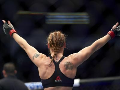 Valentina Shevchenko of Kyrgyzstan celebrates her TKO victory over Katlyn Chookagian in their women's flyweight championship bout during the UFC 247