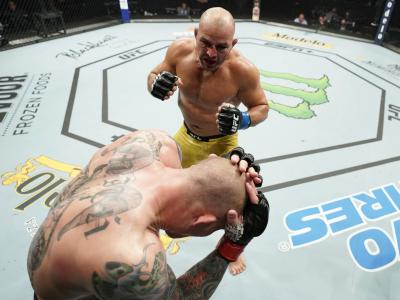Glover Teixeira of Brazil (top) fights Anthony Smith in their light heavyweight bout during the UFC Fight Night