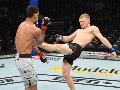 ANAHEIM, CALIFORNIA - AUGUST 17: (R-L) Casey Kenney kicks Manny Bermudez in their catchweight bout during the UFC 241