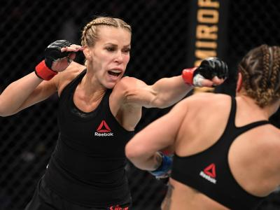 Katlyn Chookagian punches Jennifer Maia of Brazil in their women's flyweight bout during the UFC 244