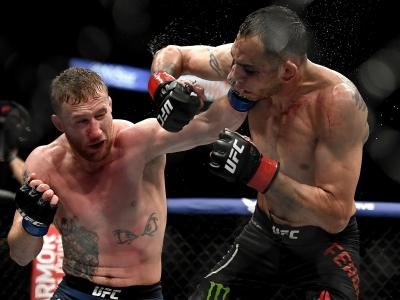 JACKSONVILLE, FLORIDA - MAY 09: Justin Gaethje (L) of the United States punches Tony Ferguson (R) of the United States in their Interim lightweight