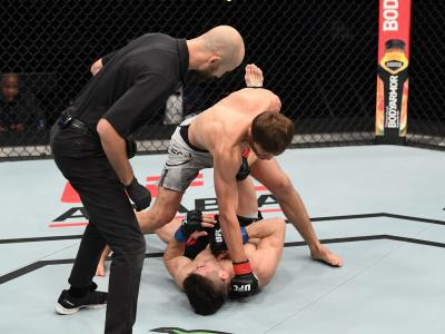 ABU DHABI, UNITED ARAB EMIRATES - OCTOBER 18: In this handout image provided by UFC, Said Nurmagomedov of Russia punches Mark Striegl