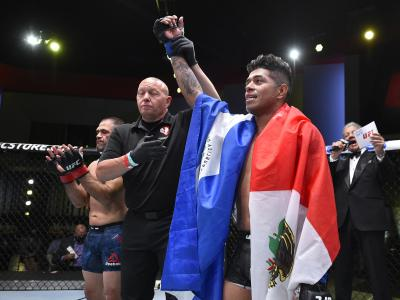 Jonathan Martinez poses for a portrait after his victory during the UFC Fight Night event at UFC APEX o