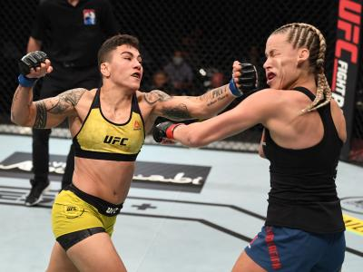 ABU DHABI, UNITED ARAB EMIRATES - OCTOBER 18: (L-R) Jessica Andrade of Brazil punches Katlyn Chookagian in their women's flyweight
