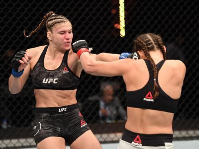 ABU DHABI, UNITED ARAB EMIRATES - OCTOBER 24: (L-R) Miranda Maverick punches Liana Jojua of Georgia in their women's flyweight bout