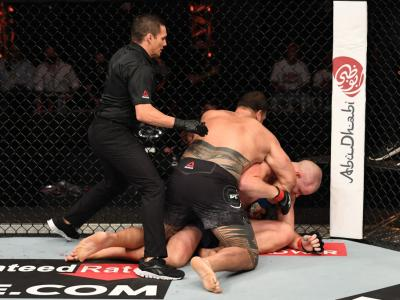 ABU DHABI, UNITED ARAB EMIRATES - OCTOBER 24: (L-R) Tai Tuivasa of Australia punches Stefan Struve of The Netherlands in their heavyweight bout during the UFC 254