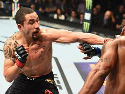 CHICAGO, ILLINOIS - JUNE 09: (L-R) Robert Whittaker of New Zealand punches Yoel Romero of Cuba in their middleweight fight